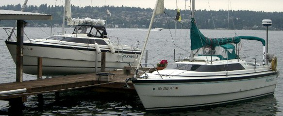Mac26x on lift showing belly and<br /><br /> Mac26x in water, belly providing foredeck stability exceeding the M and classics
