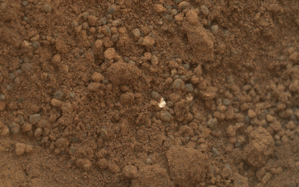 White object in Martian soil.