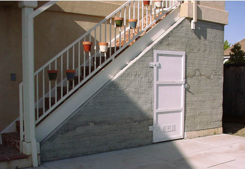 Enclose volume under exterior stairs for storage. Fabricate and hang exterior door. Fabricate supports and mount flowerpots to railing. & Remodel and additions for DB