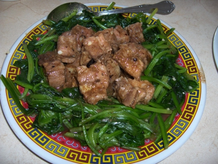 Slow cooked pork ribs with black bean sauce and mustard greens